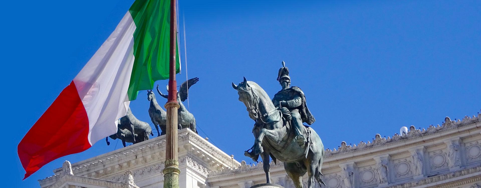statue of an Italian king near an Italian flag