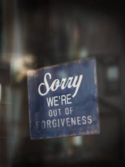 Out of forgiveness sign on window