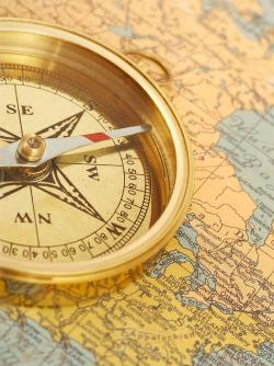 Antique compass on a New England map