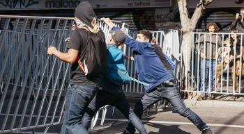 youth tearing down a barricade