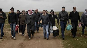 a group of Syrian refugees entering Europe