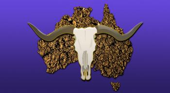 a dry cracking shape of Australian continent overlaid with a cow skull