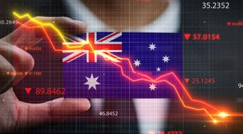 hand holding australian flag with downward trending arrows