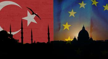 sillhouettes of a mosque and cathedral with islam and eu imagery in the background