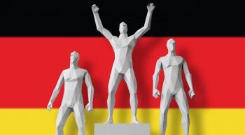 men on award podium in front of German flag