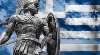 Ancient Greek soldier with modern Greek flag
