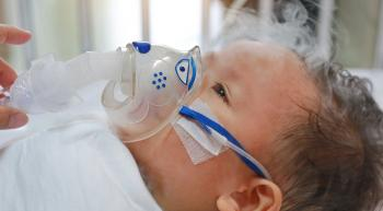 infant with an oxygen mask