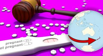 gavel and a pregnancy test with abortion pills scattered. also a globe with an arrow pointed at New Zealand
