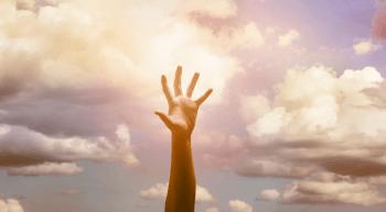 hand reaching upward as if reaching out to God