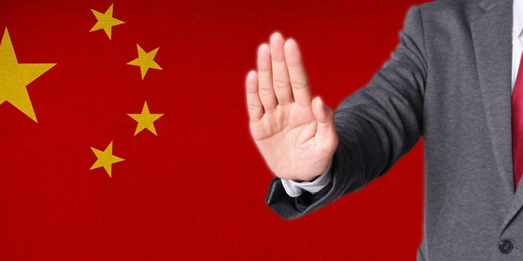 chinese flag with a man holding out hand in rejection