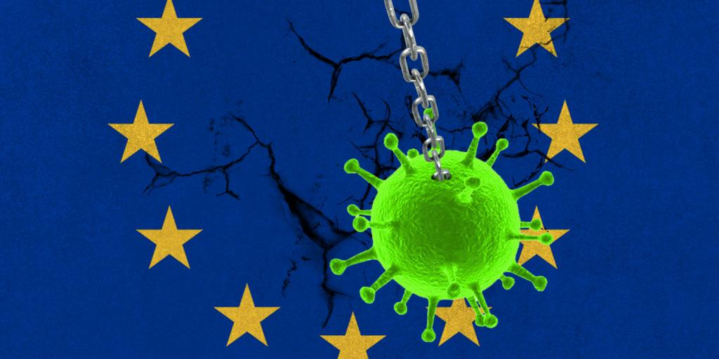 corona virus wrecking ball smashing into wall with EU flag  painted on it