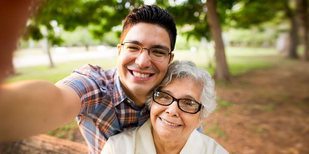 "man taking a selfie with ""grandma"""