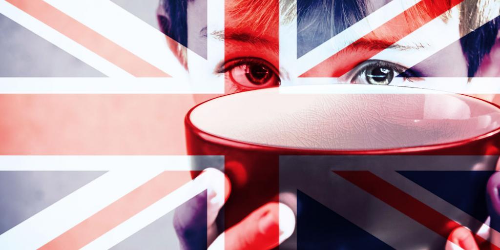 child holding up empty bowl with British flag