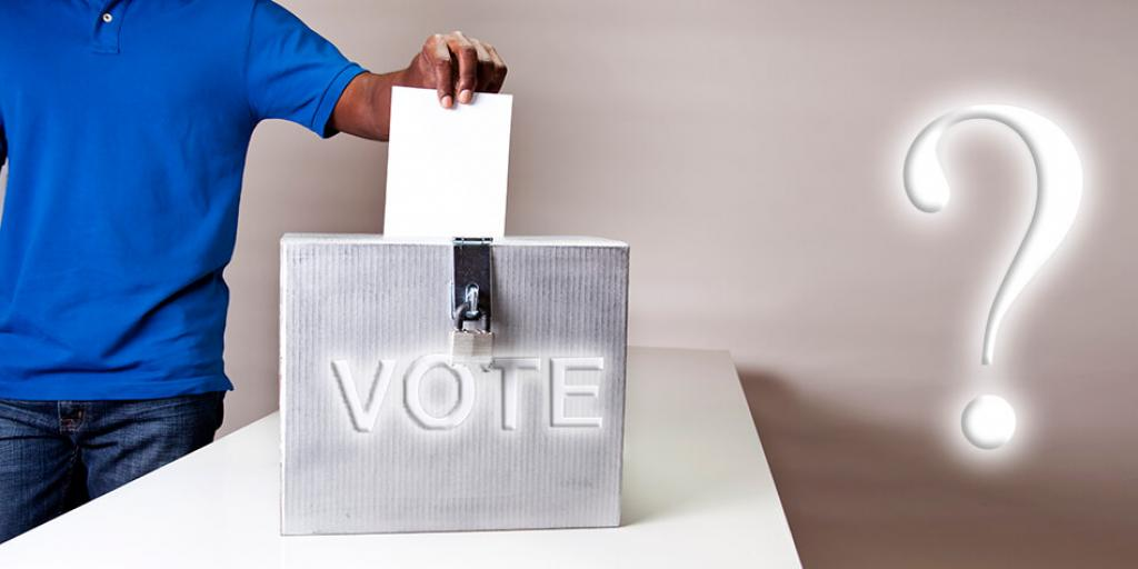 person putting paper in ballot box with question mark to the side