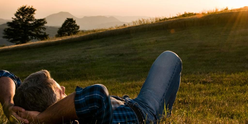 man relaxing in a peaceful field