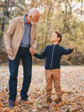 Grandfather and grandson walking outdoors