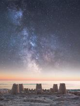 Sandcastle and starry sky