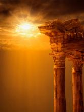 Ruins of a Greek temple in sunset
