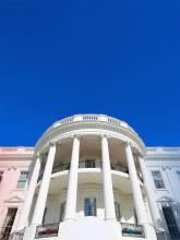 White House with red and blue flowers
