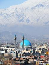Kabul with mountains in the background and blue dome mosque